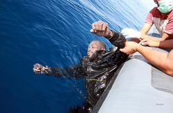 Coastguard-pulls-drowned-man-out-of-water-from-coast-of-Libya